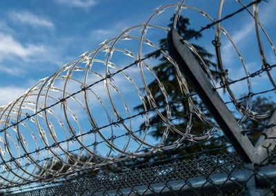 razor wire fencing installed at PG&E Chico for utility security