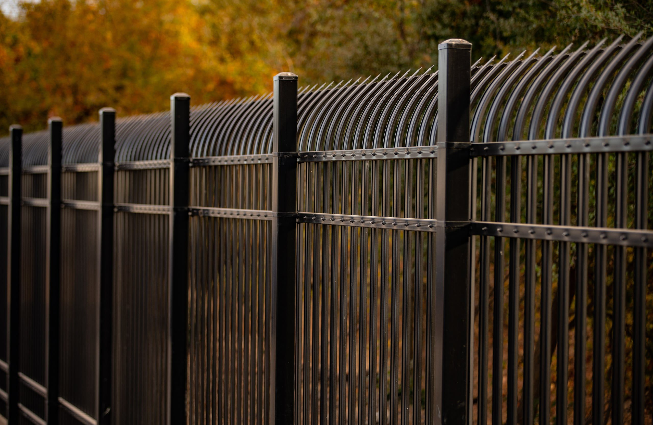 Iron picket fencing built by Crusader Fence commercial contractor for PG&E utility